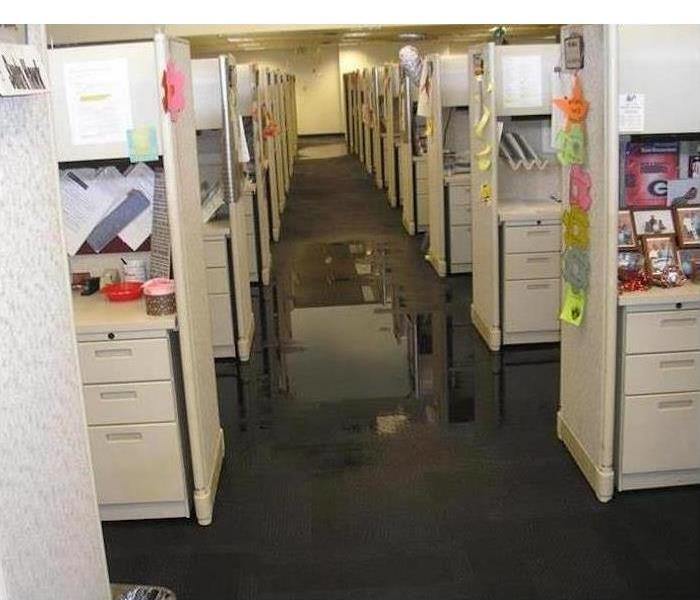 Flooded carpeted floor with water standing in office building