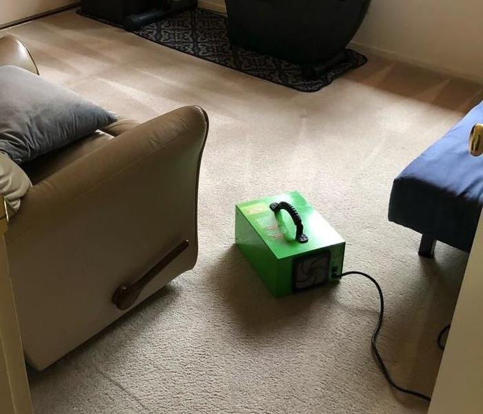 chair in living room with ozone machine on floor