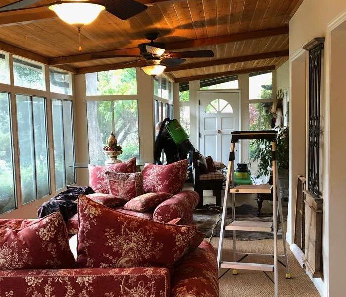 Sun room being cleaned by SERVPRO technicians